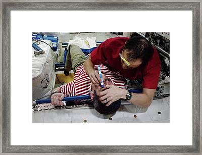 Iss Astronaut Eye Exam Framed Print by Nasa