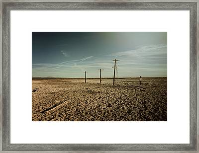 It Was A Strange Day Framed Print by Laurie Search