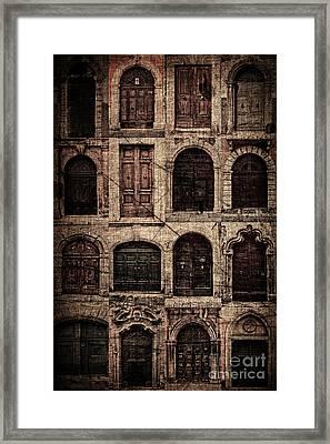 Italian Doors. Framed Print by Juan Nel