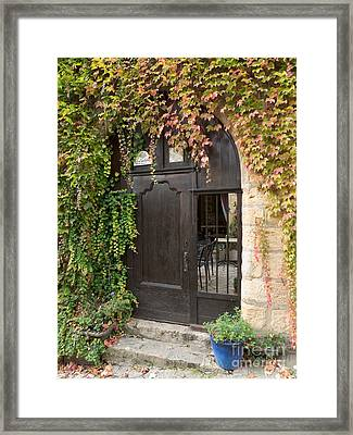 Ivy Covered Doorway Framed Print by Paul Topp