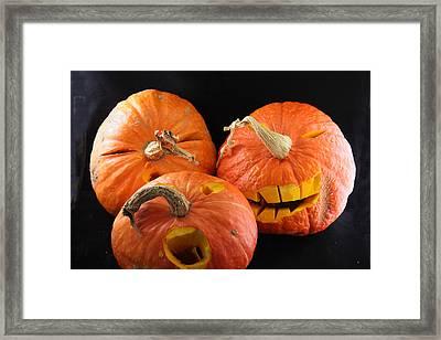 Orange Jack-o-lanterns Anticipating Halloween Framed Print by Michael Riley