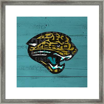Jacksonville Jaguars Football Team Retro Logo Recycled Florida License Plate Art Framed Print by Design Turnpike