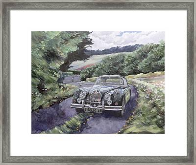 Jaguar Xk150 Cruising Framed Print by Clive Metcalfe