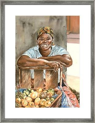 Jamaican Fruit Seller Framed Print by John Clark