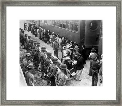 Japanese-americans Arrive By Train Framed Print by Everett
