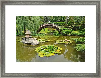 Japanese Garden With Moon Bridge And Lotus Pond With Koi Fish. Framed Print by Jamie Pham