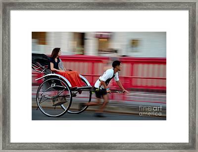 Japanese Tourists Ride Rickshaw In Tokyo Japan Framed Print by Imran Ahmed