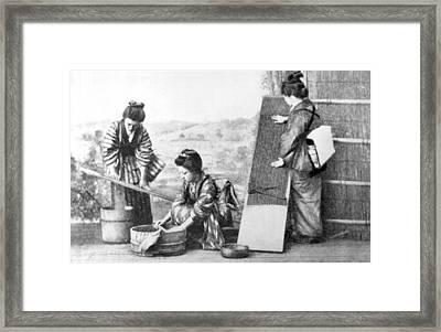 Japanese Women Doing Laundry Framed Print by Underwood Archives