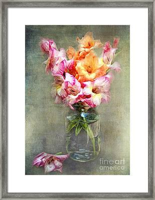 Jar Of Gladiolas Framed Print by Lena Auxier