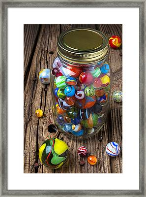 Jar Of Marbles With Shooter Framed Print by Garry Gay