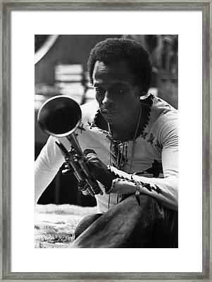 Jazz Musician Miles Davis Looking At His Trumpet Framed Print