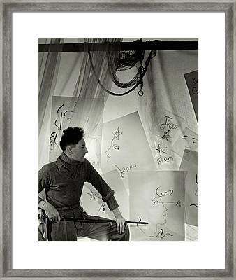 Jean Cocteau With A Cane And Drawings Framed Print