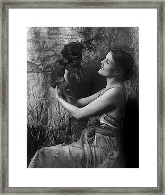 Jeanne Eagels Lifting Up A Small Dog Framed Print