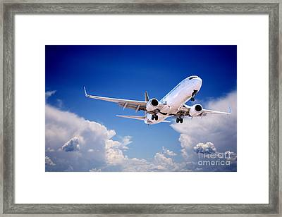 Jet Aeroplane Landing Through Gap In Stormy Sky Framed Print by Colin and Linda McKie
