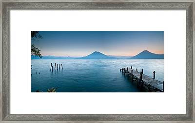 Jetty In A Lake With A Mountain Range Framed Print