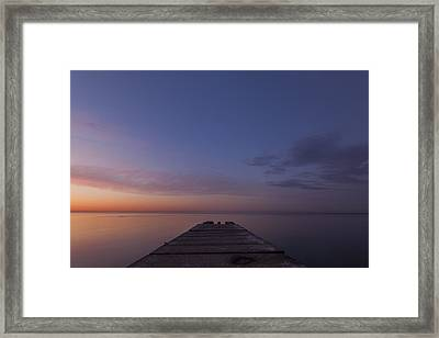 Jetty Into The Light Framed Print by CJ Schmit
