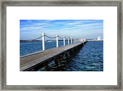Jetty Stretching To The Ocean Framed Print by Kaye Menner