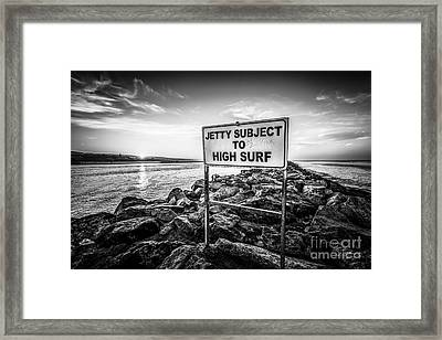 Jetty Subject To High Surf Sign Black And White Picture Framed Print by Paul Velgos