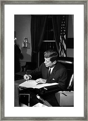 Jfk Signing The Cuba Quarantine Framed Print by War Is Hell Store
