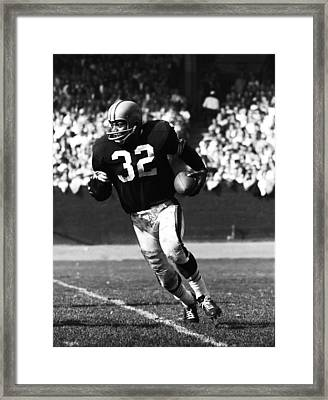 Jim Brown Running Down Field Framed Print by Retro Images Archive