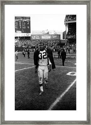Jim Brown With Coat Over Shoulder Pads Framed Print by Retro Images Archive