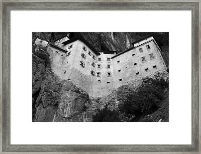 Framed Print featuring the photograph Jim Jam Predjama Castle Slovenia by Graham Hawcroft pixsellpix