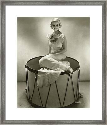Joan Bennett Sitting On An Oversized Drum Framed Print by Edward Steichen