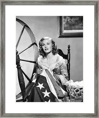 Joan Caulfield As Betsy Ross, Sewing Framed Print by Everett