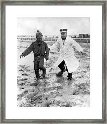 Jockey Rescued From The Mud Framed Print by Underwood Archives