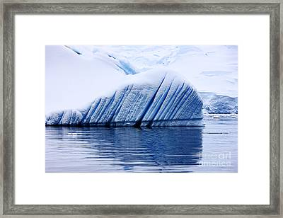 Joe Fox Fine Art - Snow Covered Iceberg Showing Blue Ice Lines Created By Bubbles And Fresh Water Floating In The Sea Framed Print by Joe Fox
