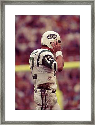 Joe Namath Fixing Helmet Framed Print