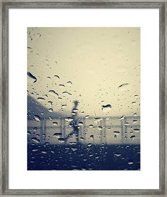 Jogger In The Rain  Framed Print by Empty Wall