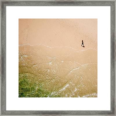 Jogger On Tallow Beach. Byron Bay. Australia. Framed Print