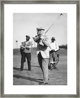 John D. Rockefeller Golfing Framed Print by Underwood Archives