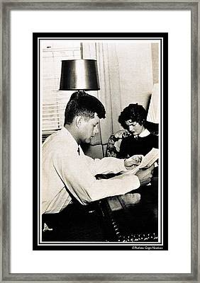 John F Kennedy And Jacqueline Studying At Home  Framed Print by Audreen Gieger