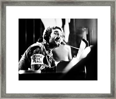 John Lennon Instant Karma Framed Print by Chris Walter