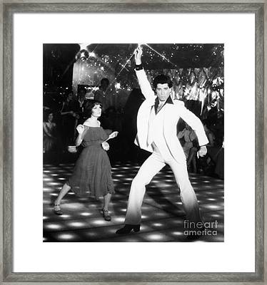 John Travolta (1954- ) Framed Print by Granger