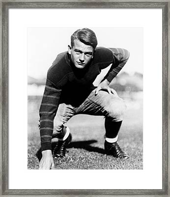 John Wayne, On The Usc Football Team Framed Print by Everett