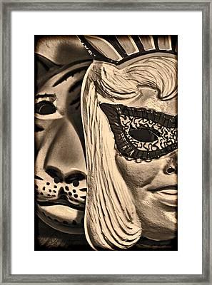 Joking Masks Framed Print by Jeff  Gettis