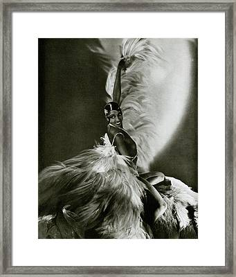 Josephine Baker Wearing A Feathered Cape Framed Print by George Hoyningen-Huene