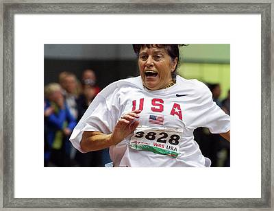 Joyful Older Female Athlete Running Framed Print
