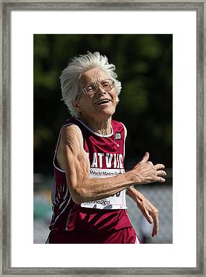 Joyful Senior Female Athlete Framed Print