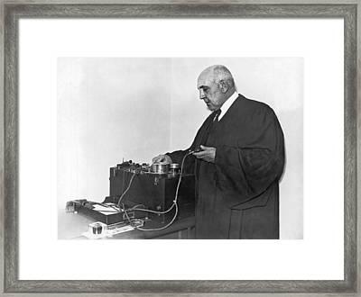 Judge Examines Lie Detector Framed Print