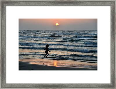 Jumping For Joy Framed Print by Debra Martz