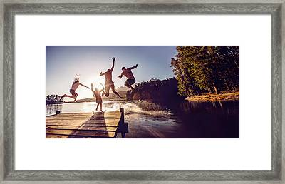 Jumping Into The Water From A Jetty Framed Print by Wundervisuals
