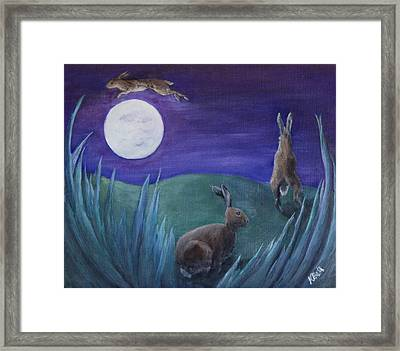 Jumping The Moon Framed Print