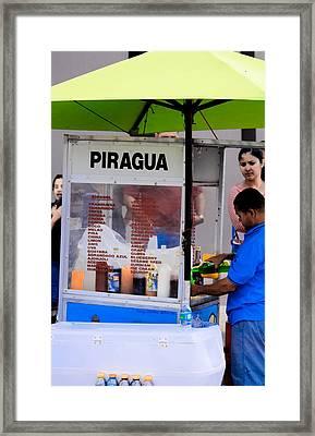Jun El Piraguero Framed Print by Sandra Pena de Ortiz