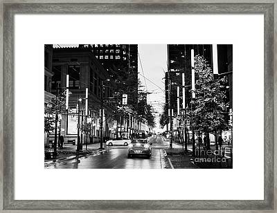 junction of west pender street and granville downtown city at night Vancouver BC Canada Framed Print