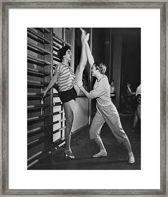 June Taylor Stretches Dancer Framed Print by Underwood Archives