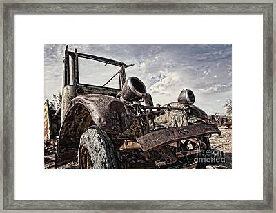 Junk Yard Sentinel Stands  Framed Print by Lee Craig